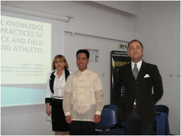Striking a pose after my research oral presentation with the Vice Dean of the Faculty of Physical Education and Sport.