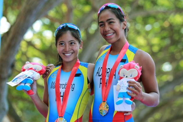 28th SEA Games Singapore 2015 - East Coast Park, Singapore - 6/6/15 Triathlon - Women's Individual - Philippines' Ma Claire Adorna (R) and Marion Kim Mangrobang hold their gold and silver medals respectively SEAGAMES28 Mandatory Credit: Singapore SEA Games Organising Committee / Action Images via Reuters