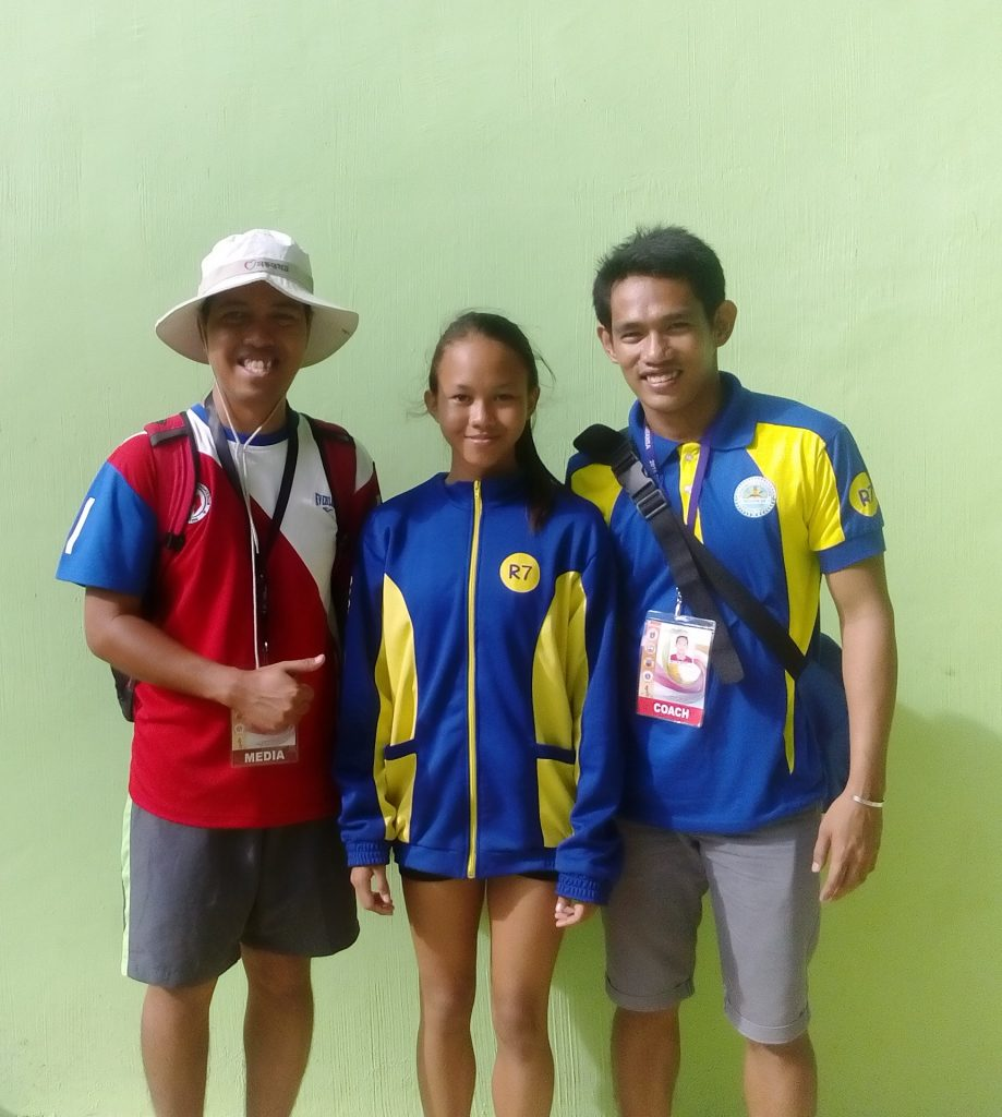 Prof. Airnel T. Abarra with Samantha Limos and Coach Anthony Santillan just after her victory in the 200m dash.