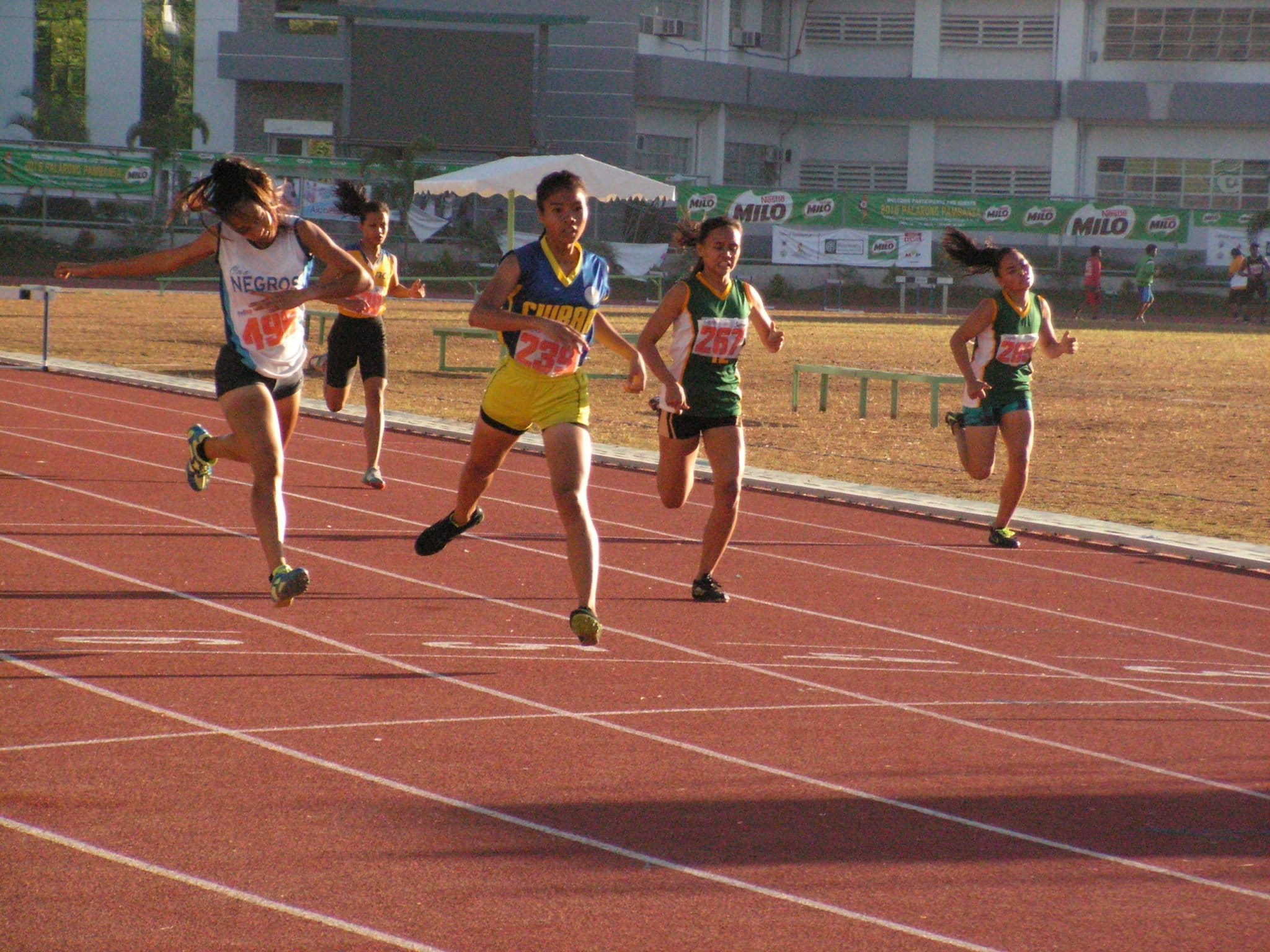 Riza Jane Valiente with her upset victory in the 400m hurdles secondary girls
