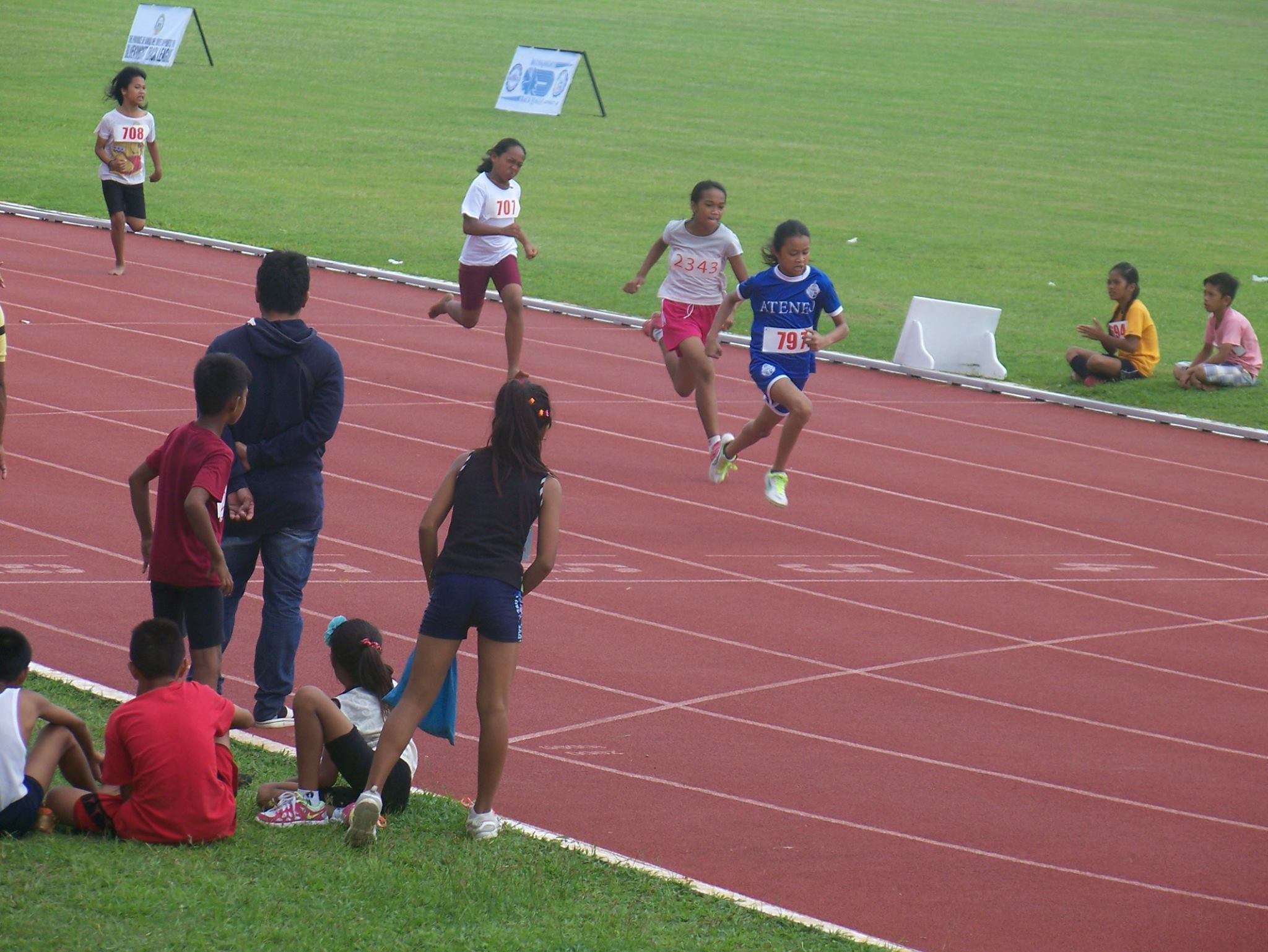 Ateneo de Davao's Ashanttie Kate Amaneo on her final stretch at 100m dash.