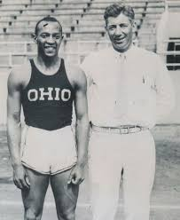Jesse Owens with his coach Larry Snyde